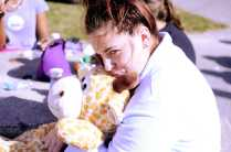 Noelle Pouzar (12) hugs her stuffed giraffe in the courtyard during third lunch. Photo by: Jack Steele Mattingly