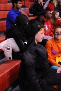"""Sam Coryell (11) hangs out with friends as """"Batman"""" at the pep rally. Photo by Jack Mattingly"""