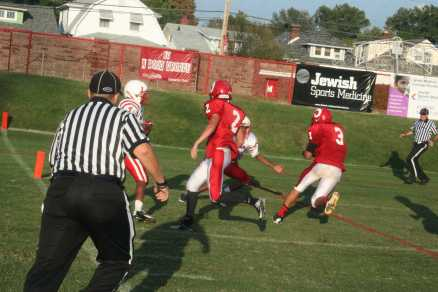 Timothy Comstock (9,#3) making the first touchdown leading the crimsons to victory.