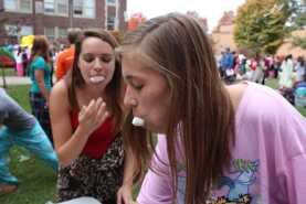 Kylie Krupilski (10) plays Chubby Bunny with a friend at the Executive Council booth. Photo by Julia Nguyen