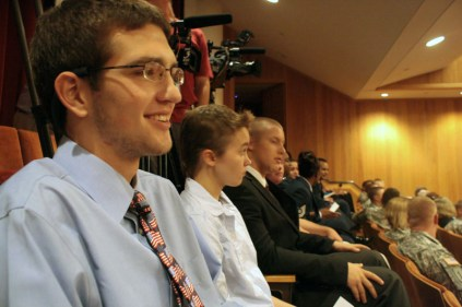 Corbin Mosser (12) smiles as he listens to General Petraeus speak.