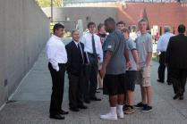 Students of Mr. Garrett's Military History class wait outside with Mr. Garrett after the speech.