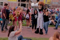 The University of Denver's mascot makes an appearance to pose with students.