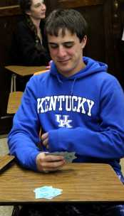 Matthew Seelbach (11) plays his poker face in a game of cards after the PSAT.