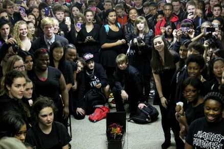 Students gather around the casket to listen to the eulogy given by Assistant Principal Mr. Greg Kuhn. Photo by Mesa Serikali
