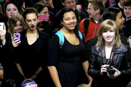 Emma Harris (11), Kylie Grey (11), and Meg Shanks (11) attend the Burial of the Bulldog, and catch a good spot in the front of the crowd. Photo by Mesa Serikali