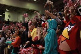 """The class of 2014 screams """"White!"""" during the Red/White cheer against the senior class. Photo by Meg Shanks"""
