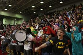 """Yelling with all of their might, the juniors scream """"WHITE"""" at the pep rally. Photo by Molly Loehr"""