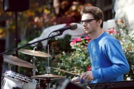 Price McGuffey (12) plays drums and keyboard with his bandmates as the first act of Ramstock commences.
