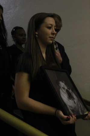 Students walked in a line as they held the bulldog's picture.