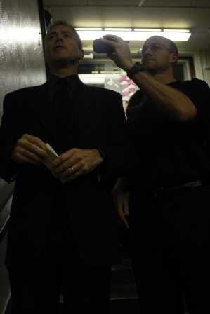Mr. Kinsley held the walkie talkie in order for Mr. Kuhn's speech to be heard through the speakers.