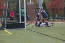 Renee DuFour (11, #15) dives for the ball in attempt to score. Photo by Kinsey Ball