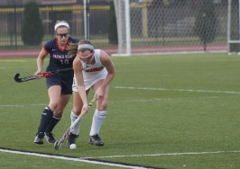 Kelsi White (12, #19) dribbles the ball.