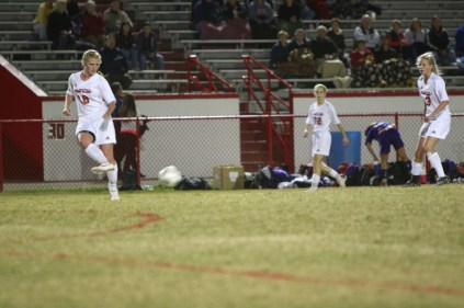 Max Zimmer (12) passes the ball towards the inside to a teammate headed towards the goal.