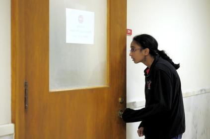 Nivedita Khandkar slowly opens the door and peeks to make sure her team is there. After a long car ride due to backed-up traffic, the members of the JV quick recall arrived an hour behind on schedule, but were able to still attend to their first Quiz Bowl at Western Kentucky University on October 27, 2012. photo by Yazmin Martinez