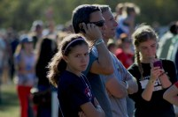 Spectators wait anxiously for the runners to pass by on the final leg of the three mile race.