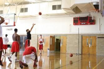 Miles Thompson (12), Andy Tilman (12), Simon Clifford (12), and Raleigh Dixon (11) take turns shooting during warm ups.
