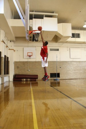 Andy Tilman (12) practices his dunks making sure he is ready for his first game.