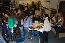 The newspaper staff gather around the tables in room 253, and fill their plates. Photo by Molly Loehr.