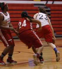 Destiny Curry guards Claire Ackerson.