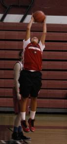 Lydia Biggs jumps to catch a rebound during practice.