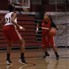 Sophomore, Teanna Curry, dribbles the ball while being guarded by Mackinley Poole.