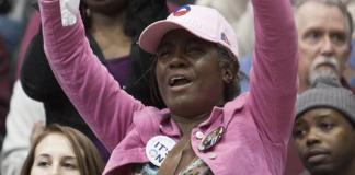 An Obama supporter waves a sign during his speech at the University of Cincinnati. Photo by Yazmin Martinez.