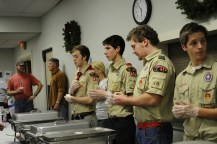Older scouts lined up at their own respective stations to serve food for the soon-to-arrive supporters. Photo by Jack Steele Mattingly