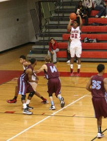 Miles Thompson (12) shoots three-pointer. Photo By: Alexis Weaver