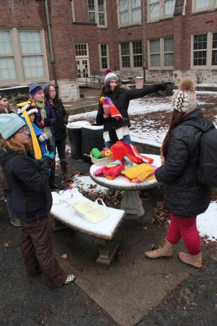 Nathalie Pouzar (Alumni) instructs students on how to yarn-bomb. Photo by Kelsi White.