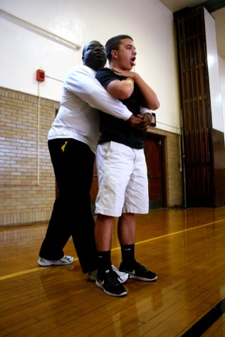 Jacob Avetisian (9) volunteers to show the class how you relieve a choking person. Photo by Clara Lewis