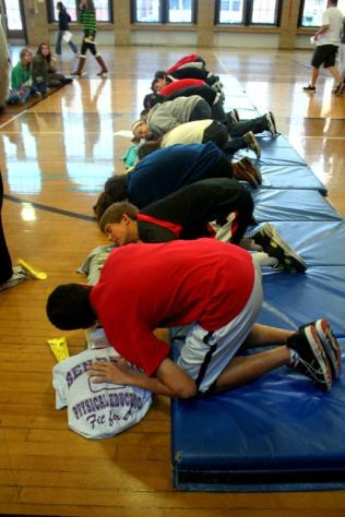 Students demonstrate to the rest of the class the steps needed to give someone cpr. Photo by Clara Lewis