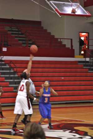 Kayla Styles (12, #10) wins the tip-off to start the game