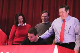 Brian Habacivch (12) signs with Boston University for a swimming scholarship.