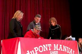 Harrison Scanlon (12) signs to play baseball at Western Kentucky University.