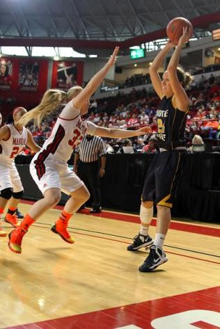 Katie Long (#33, 12) blocks a Notre Dame player.
