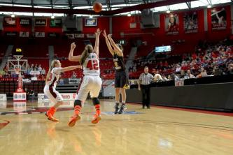 Tabitha Mitchell (#42, 11) and Long block a three-point attempt by Notre Dame.