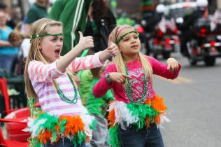 """""""Yeah! That is what I'm talking about!"""" encouraged two girls to all the people in the parade. Photo by Molly Loehr"""