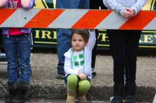 Kids bent down, sat on grown up shoulders, or jumped up and down, to see the green floats. Photo by Molly Loehr