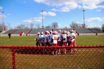 Manual's Varsity Lacrosse team prepares themselves to face against their rival: Male.