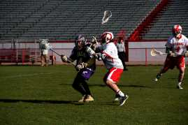 A Manual player checks one of Male's players trying to make him drop the ball.