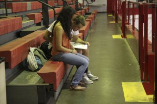 Avni Hajela (11) and Alex Rubino (11) spent time looking through the yearbook together. Photo by Kinsey Ball.