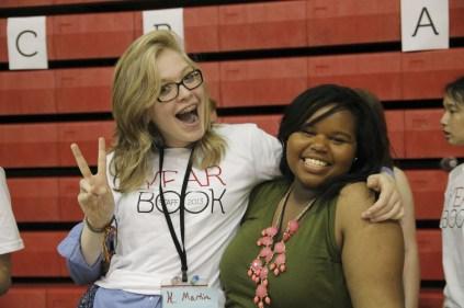 Kayla Martin (10) and Ron'Niscia Cole (10) posed to commemorate yearbook distribution. Photo by Mai Nguyen.