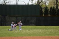 Outfielders huddle during a timeout.