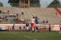 Greg Healey (12, #13) jumps high for a chance to head the ball back into possession