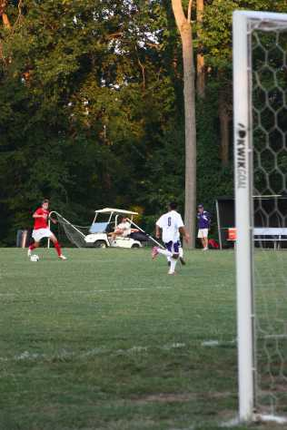 Noah Braden (11, #23) works the ball back and forth towards the goal
