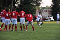 Manual's varsity players form a wall to deflect a free kick from Male.