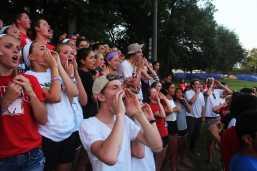 Fellow Manual students cheer on Manual's varsity team.