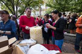 PTSA volunteers hand out popcorn to students. Photo by Jack Steele Mattingly