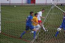 Dylan Barth (9, #45) scores Manual's third goal of the night and watches the ball sting the corner of the net